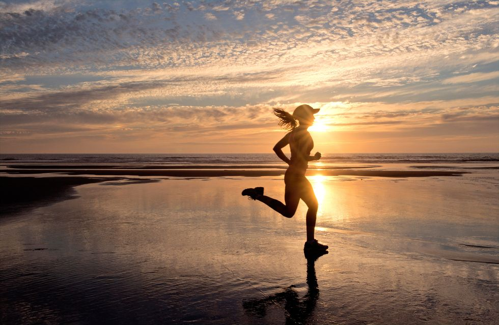 woman running on beach in morning, runner's high